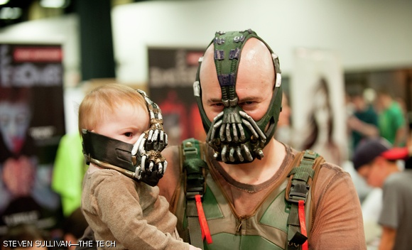 A Bane cosplayer walks the halls of Comic Con with his protege Baby-Bane & Photo - Volume 133 Issue 30 - The Tech